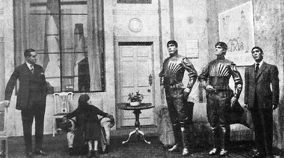 Scene from R.U.R. depicting three robots.